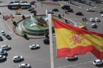 View from the top of Cybele Palace (Palacio de Cibeles) down to the Plaza de Cibeles in Madrid and the Spanish flag.