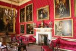 Red Drawing Room of Blenheim Palace with three paintings from Van Dyck around the fireplace. It was originally used as a billiard room and a library.