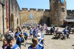 "Children heading for the ""Knight's Quest"" courtyard of Alnwick Castle"