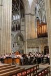 Choir singing next to the main altar of York Minster
