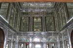 The walls and ceiling of the small pavilion inside Ghavam Garden is covered with small mirrors