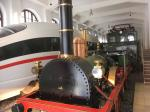 "Reconstruction of the ""Adler"", the first locomotive used for regular commercial operations in Germany. Originally built in 1835 by Robert Stephenson and Company in England. Locomotive is on display in the Nuremberg Transport Museum (DB Museum)."